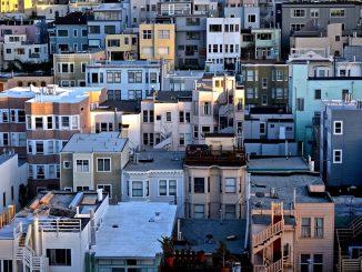 white and black concrete buildings by doanstopexploring (Unsplash.com)