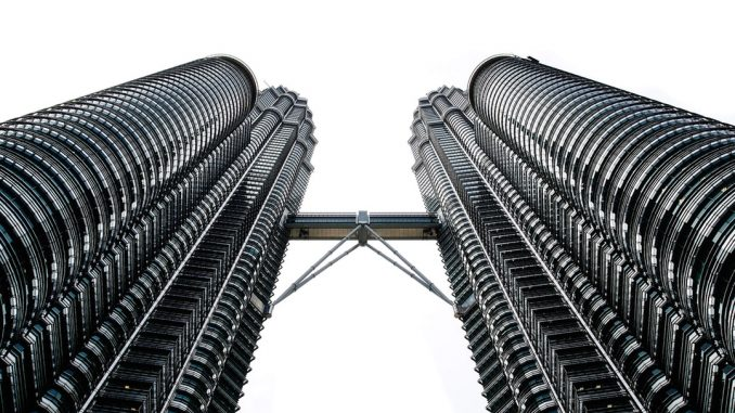 worms eyeview photography of Petronas Tower during daytime by iampatrickpilz (Unsplash.com)