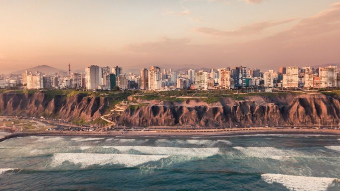 road near body of water and buildings at daytime by willianjusten (Unsplash.com)