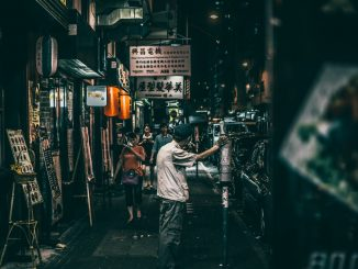 people on street between stores by aiksooon (Unsplash.com)