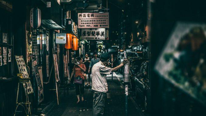 people on street between stores by aiksooon (Unsplash.com)