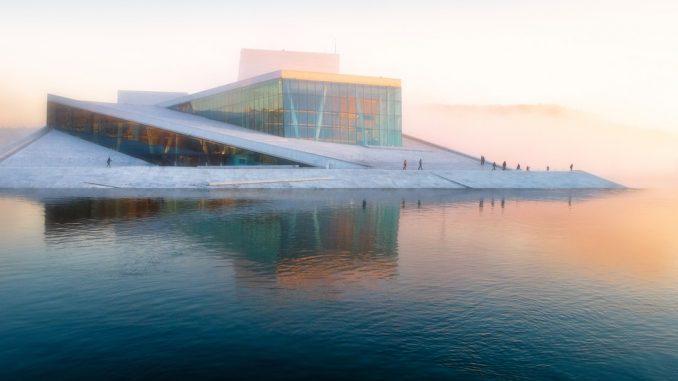 gray building near body of water under white sky by vidarnm (Unsplash.com)