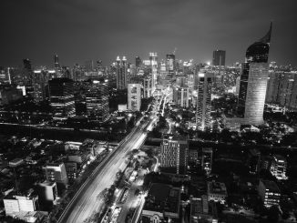 grayscale photo of cityscape by bagusghufron (Unsplash.com)
