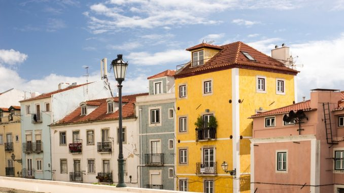 Some of the renovated house at one of the streets next to the Panton in Lisbon. by annadziubinska (Unsplash.com)