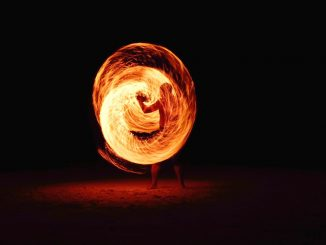 Firedancing man by pj24dm (Unsplash.com)