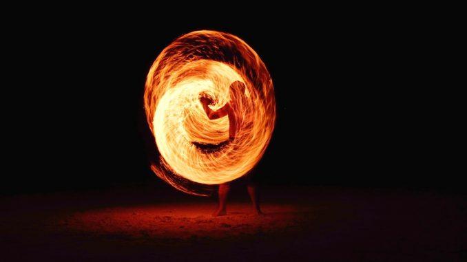 Firedancing man by pj24dm (Unsplash.com)