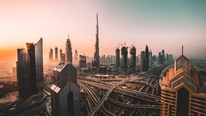 Sunrise shot of Downtown Dubai and Burj Khalifa. by david__r (Unsplash.com)