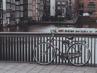 When I arrived in Amsterdam I grabbed my camera and threw it over my shoulder and went out to explore by bike. after about a hour of riding and taking pictures I stopped at this bridge to look around and the bike leaning on the bridge railed seemed iconic in its summation of the Dutch lifestyle. by rafaellodos (Unsplash.com)