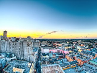 Shot from the top of the Hotel Monteleone at Sunset in New Orleans. This is looking towards Bourbon Street. It was shot during my Honeymoon there. by scottwebb (Unsplash.com)