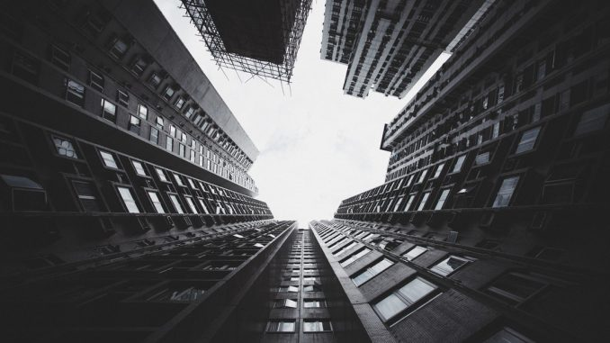 Striking apartment complex in residential Hong Kong, feels like looking up yet falling down.. by t__ram (Unsplash.com)
