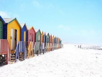 Colorful beach huts on beach by _entreprenerd (Unsplash.com)