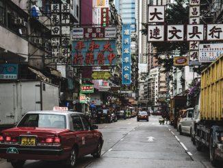 red taxi hong kong street by bantersnaps (Unsplash.com)