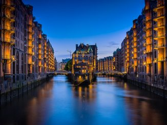 "This photo was taken in the ""Speicherstadt"" District in Hamburg (Germany). On midday this place looks kind of boring but in the late evening, the lights go on and the place turns into a great photo spot. by claudiotesta (Unsplash.com)"
